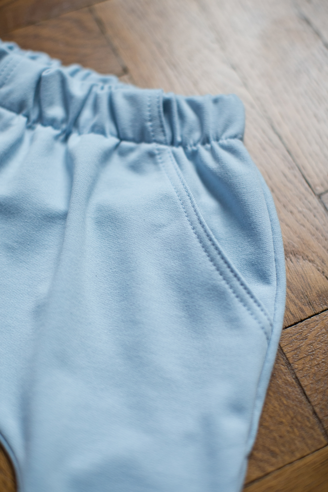 light blue trousers and tracksuit