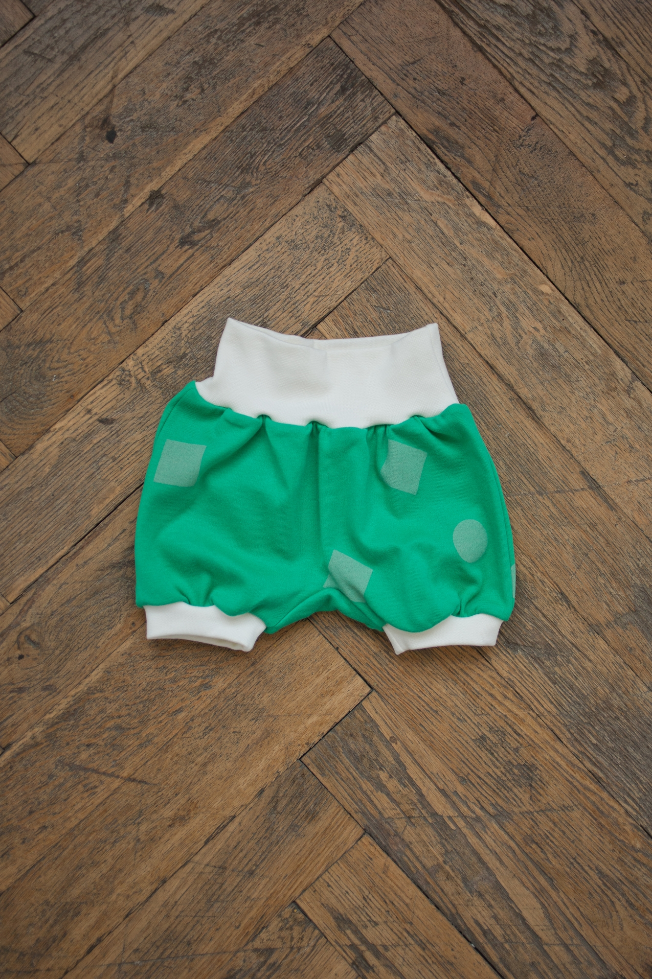 green geometry shorts