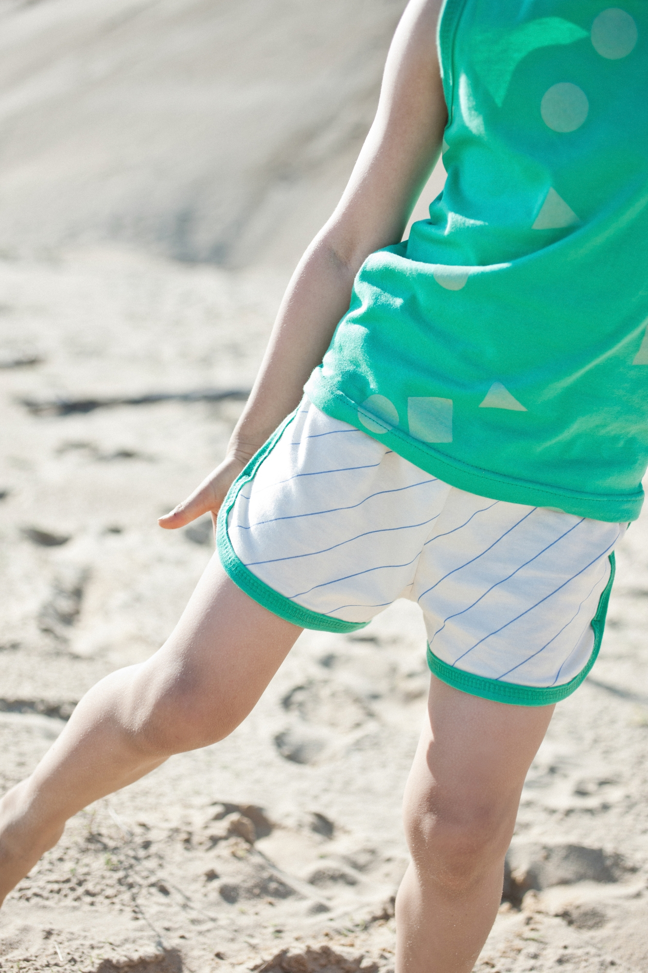green hem shorts