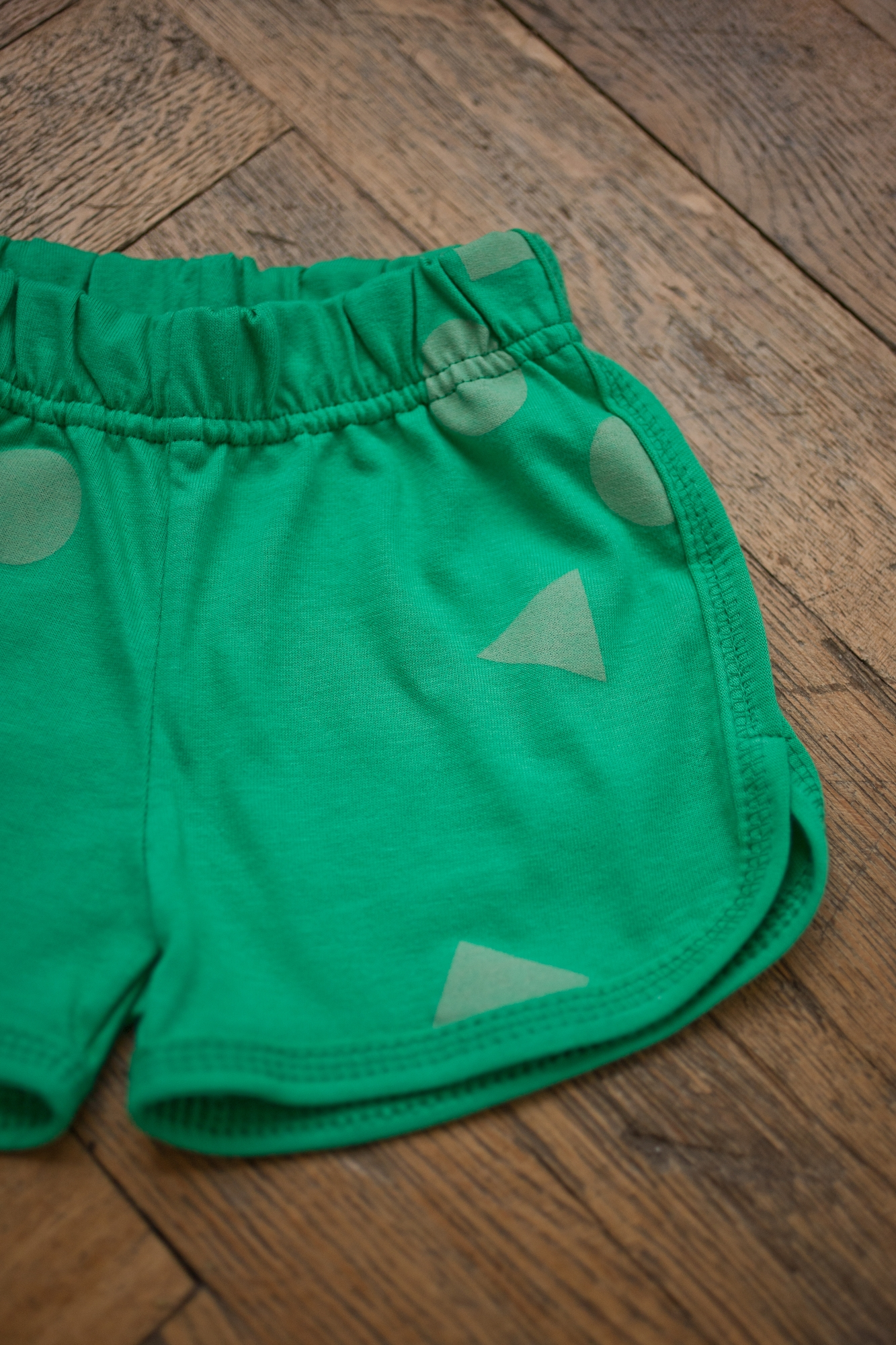 green geometry shorts